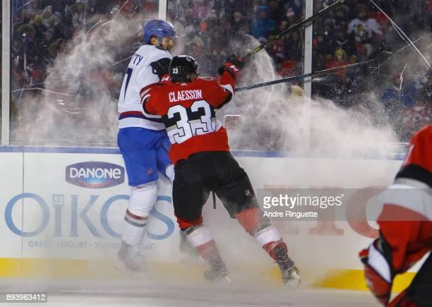 Fredrik Claesson of the Ottawa Senators body checks Max Pacioretty the Montreal Canadiens in the 2017 Scotiabank NHL100 Classic at Lansdowne Park on...