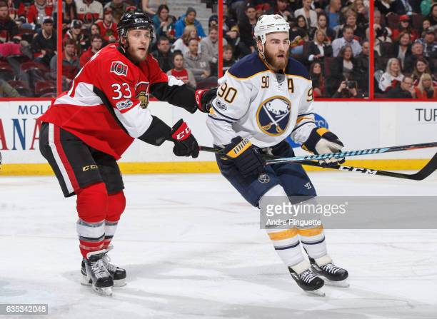 Fredrik Claesson of the Ottawa Senators defends against Ryan O'Reilly of the Buffalo Sabres at Canadian Tire Centre on February 14 2017 in Ottawa...