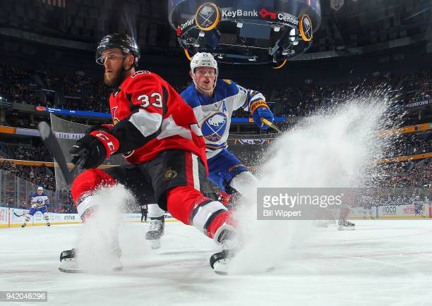 Fredrik Claesson of the Ottawa Senators makes a quick stop in front of Jack Eichel of the Buffalo Sabres during an NHL game on April 4 2018 at...