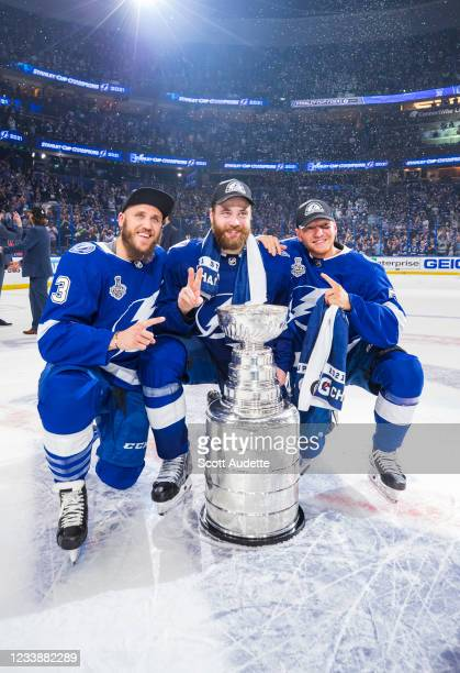 Fredrik Claesson, Victor Hedman, and Andreas Borgman of the Tampa Bay Lightning celebrates with the Stanley Cup after defeating the Montreal...