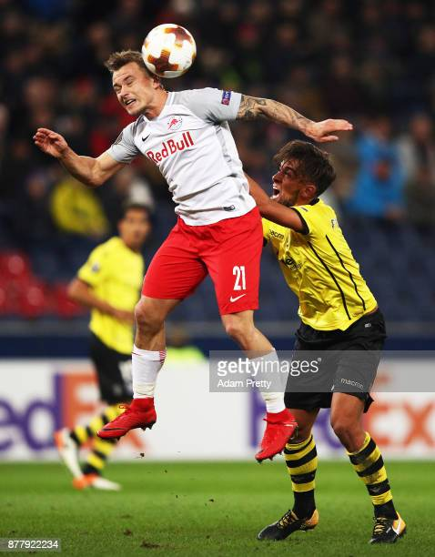 Fredrik Gulbrandsen of Red Bull Salzburg is challenged by Francisco Ramos of Vitoria Guimaraes during the UEFA Europa League group I match between FC...