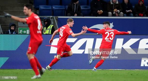 Fredrik Jensen of Augsburg celebrates with Fredrik Jensen of Augsburg after their third goal during the Bundesliga match between TSG 1899 Hoffenheim...