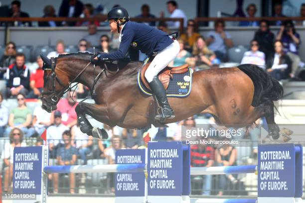 Fredrik Jonsson of Sweden riding Cold Play competes during Day 3 of the Longines FEI Jumping European Championship speed competition against the...