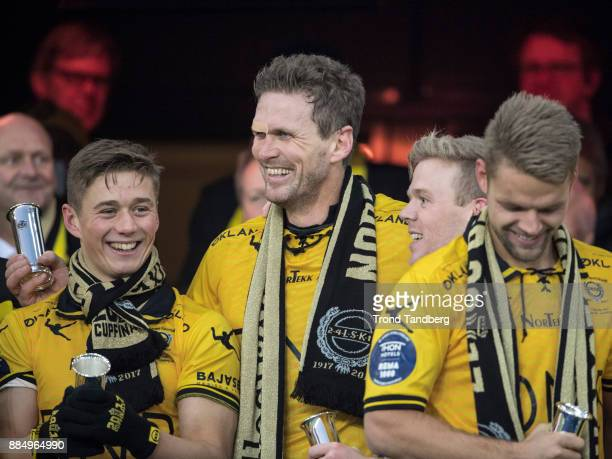 Fredrik Krogstad Frode Kippe Erling Knudtzon Mats Haakenstad of Lillestrom celebrates with Trophy after victory between Sarpsborg 08 v Lillestrom at...