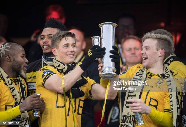 Fredrik Krogstad of Lillestrom celebrates with Trophy after victory between Sarpsborg 08 v Lillestrom at Ullevaal Stadion on December 3 2017 in Oslo...