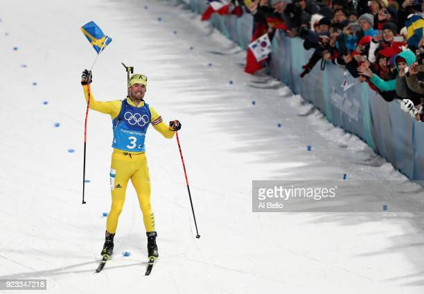 Fredrik Lindstroem of Sweden celebrates as his country win the gold medal during the Men's 4x75km Biathlon Relay on day 14 of the PyeongChang 2018...