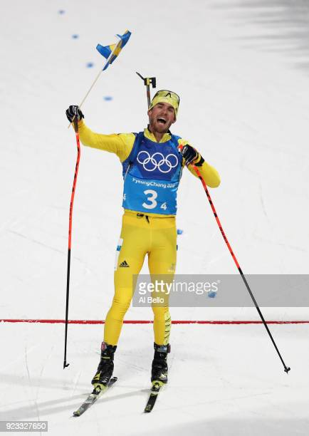 Fredrik Lindstroem of Sweden celebrates winning the gold medal during the Men's 4x75km Biathlon Relay on day 14 of the PyeongChang 2018 Winter...