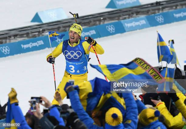 Fredrik Lindstroem of Sweden heads along the finish straight on the way to winning the gold medal during the Men's 4x75km Biathlon Relay on day 14 of...