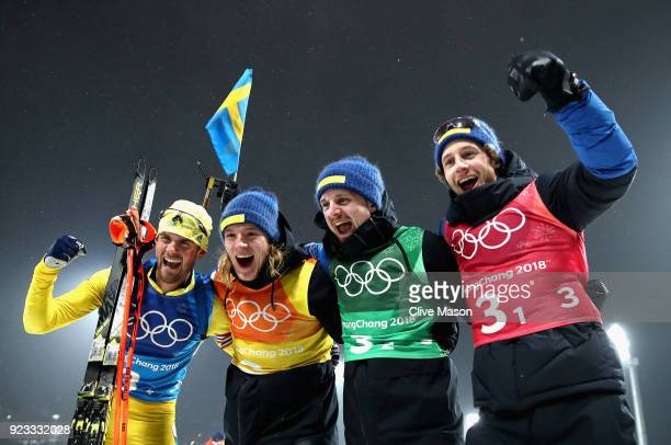 Fredrik Lindstroem Sebastian Samuelsson Jesper Nelin and Peppe Femling of Sweden celebrate winning the gold medal during the Men's 4x75km Biathlon...