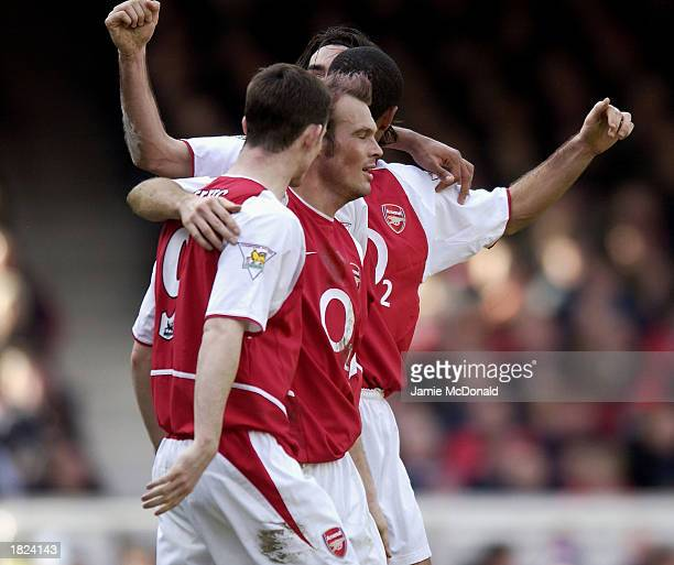 Fredrik Ljungberg and Francis Jeffers of Arsenal celebrate the second goal during the FA Barclaycard Premiership match between Arsenal and Charlton...