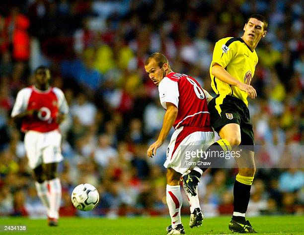 Fredrik Ljungberg of Arsenal and Gareth Barry of Aston Villa challenge for the ball during the FA Barclaycard Premiership match between Arsenal and...