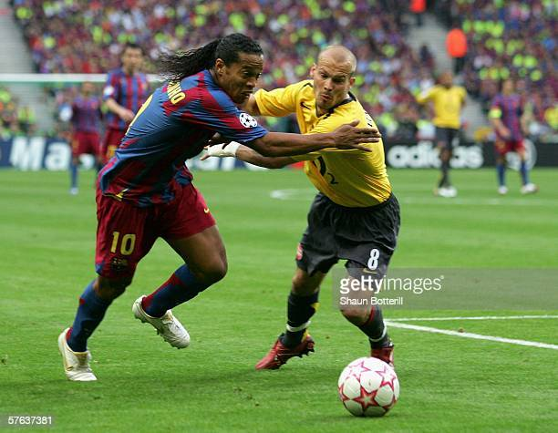 Fredrik Ljungberg of Arsenal challenges Ronaldinho of Barcelona during the UEFA Champions League Final between Arsenal and Barcelona at the Stade de...