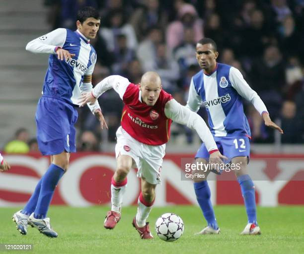 Fredrik Ljungberg of Arsenal in action against Lucho González and Jose Bosingwa of Porto during the UEFA Champions League Group G match between FC...