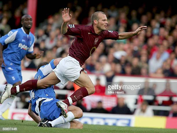 Fredrik Ljungberg of Arsenal is fouled by Kenny Cunningham of Birmingham City during the Barclays Premiership match between Arsenal and Birmingham...