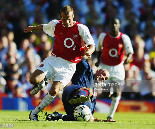 Fredrik Ljungberg of Arsenal is tackled by Steve Stone of Portsmouth during the FA Barclaycard Premiership match between Arsenal and Portsmouth on...