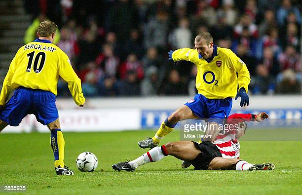 Fredrik Ljungberg of Arsenal is tackled during the FA Barclaycard Premiership match between Southampton and Arsenal at St Mary's Stadium on December...
