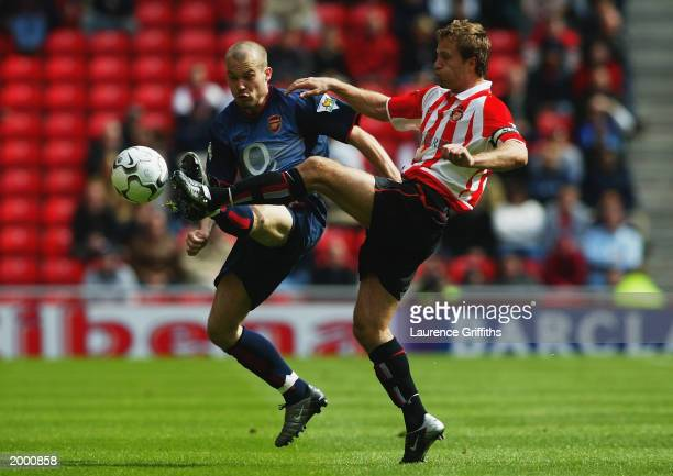 Fredrik Ljungberg of Arsenal wins the ball ahead of Michael Gray of Sunderland during the FA Barclaycard Premiership match held on May 11 2003 at the...