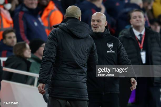 Fredrik Ljungberg of Arsenal with Josep Guardiola of Manchester City before during the Premier League match between Arsenal FC and Manchester City at...