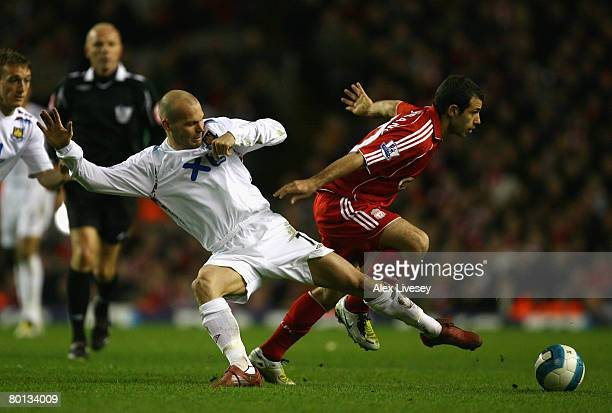 Fredrik Ljungberg of West Ham United challenges Javier Mascherano of Liverpool during the Barclays Premier League match between Liverpool and West...