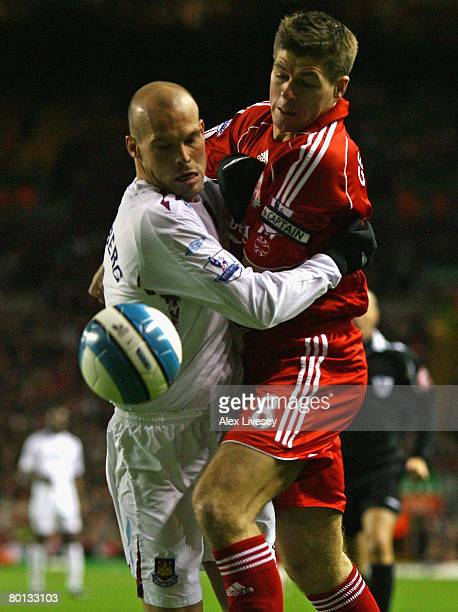 Fredrik Ljungberg of West Ham United tangles with Steven Gerrard of Liverpool during the Barclays Premier League match between Liverpool and West Ham...