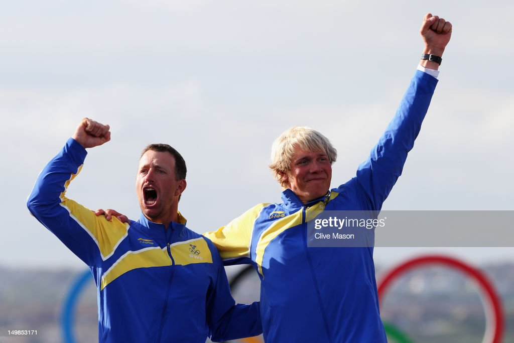 Fredrik Loof (L) and Max Salminen (R) of Sweden celebrate after winning the Men's Star Sailing on Day 9 of the London 2012 Olympic Games at the Weymouth & Portland Venue at Weymouth Harbour on August 5, 2012 in Weymouth, England.