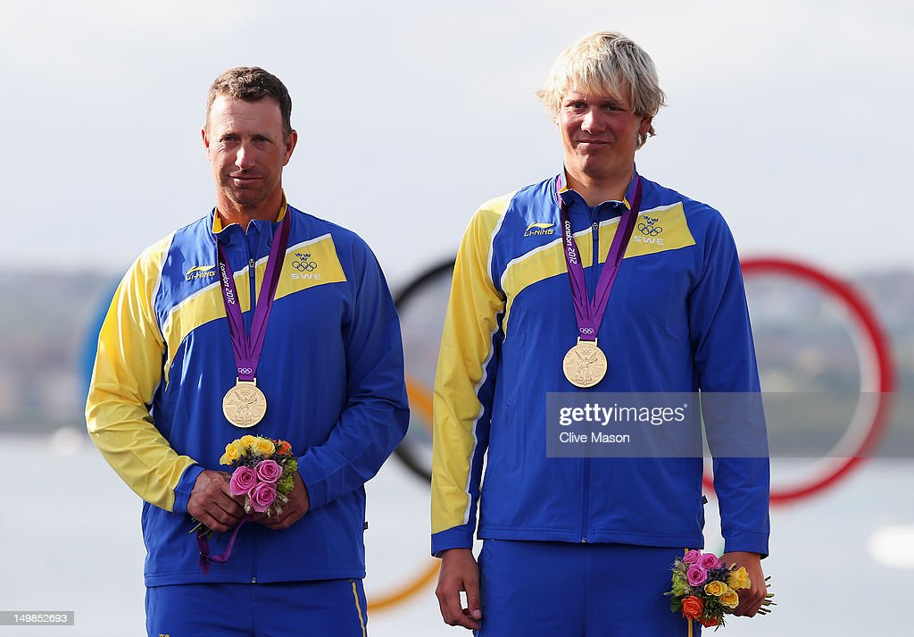Fredrik Loof (L) and Max Salminen (R) of Sweden celebrate with their gold medals after winning the Men's Star Sailing on Day 9 of the London 2012 Olympic Games at the Weymouth & Portland Venue at Weymouth Harbour on August 5, 2012 in Weymouth, England.