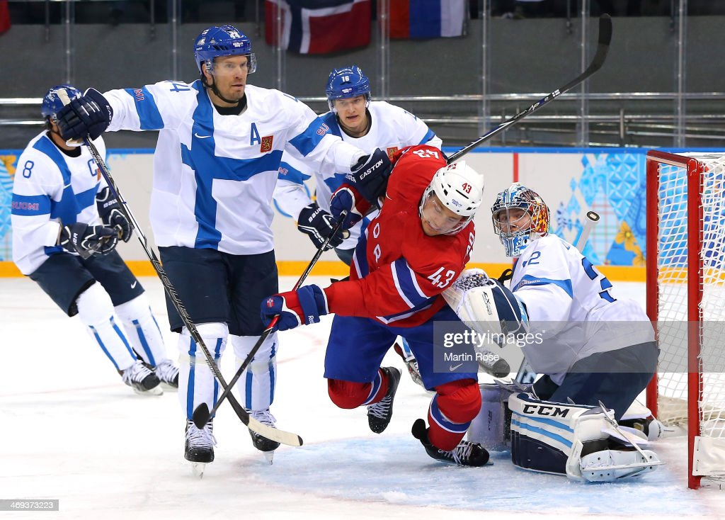 Fredrik Lystad Jacobsen #43 of Norway fights for position in front of the net against Kimmo Timonen #44 and Kari Lehtonen #32 of Finland in the second period during the Men's Ice Hockey Preliminary Round Group B game on day seven of the Sochi 2014 Winter Olympics at Shayba Arena on February 14, 2014 in Sochi, Russia.