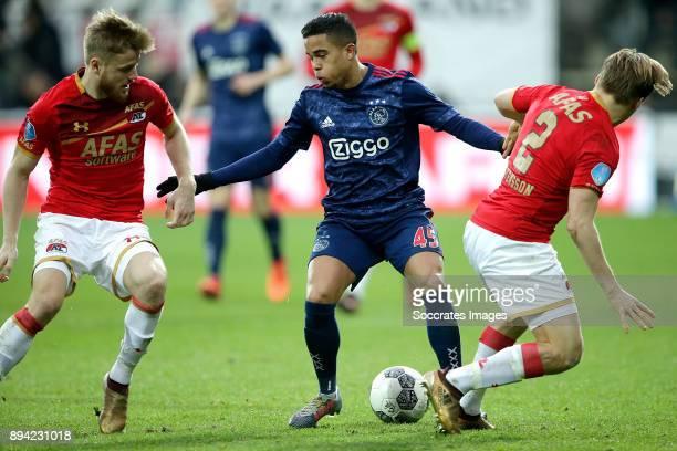 Fredrik Midtsjo of AZ Alkmaar Justin Kluivert of Ajax Jonas Svensson of AZ Alkmaar during the Dutch Eredivisie match between AZ Alkmaar v Ajax at the...