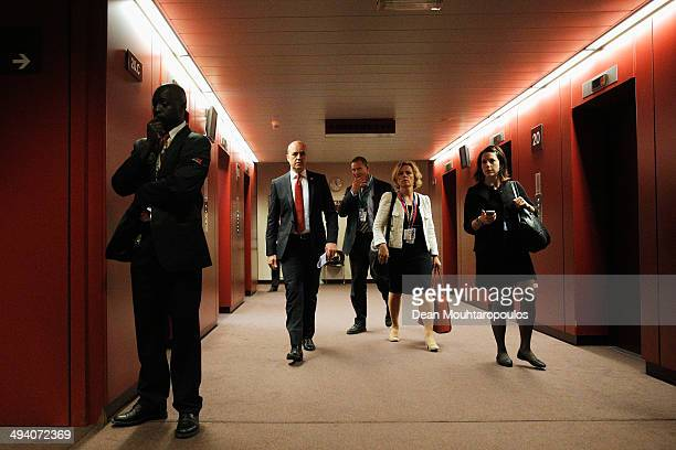 Fredrik Reinfeldt Prime Minister of Sweden walks to his room to speak to the media after the Informal Dinner of Heads of State or Government held at...
