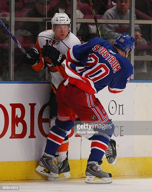 Fredrik Sjostrom of the New York Rangers checks Josh Bailey of the New York Islanders on February 18 2009 at Madison Square Garden in New York City