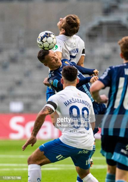 Fredrik Ulvestad of Djurgardens IF in an arial duel with Christoffer Nyman of IFK Norrkoping during the Allsvenskan match between Djurgardens IF and...