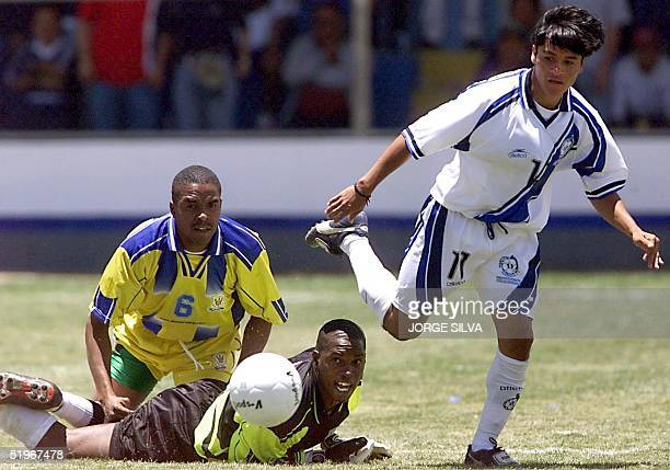 Fredy Garcia Guatemala of Guatemala Wayne Sobers and Horace Stoute of Barbados eye the ball 22 July 2000 in Quetzaltenango during their qualifying...