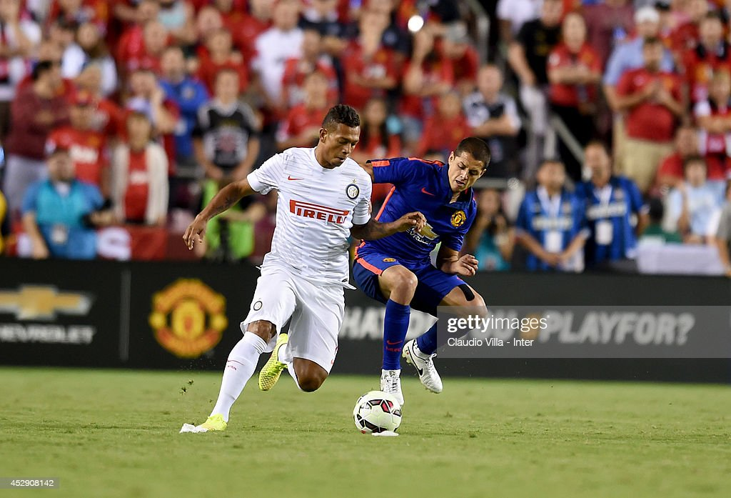 Fredy Guarin of FC Inter Milan (L) and Javier 'Chicharito' Hernandez of Manchester United compete for the ball during the International Champions Cup 2014 at FedExField on July 29, 2014 in Landover, Maryland.