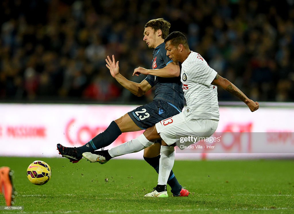 Fredy Guarin of FC Internazionale and Manolo Gabbiadini of SSC Napoli (L) compete for the ball the TIM Cup match between SSC Napoli and FC Internazionale at Stadio San Paolo on February 4, 2015 in Naples, Italy.