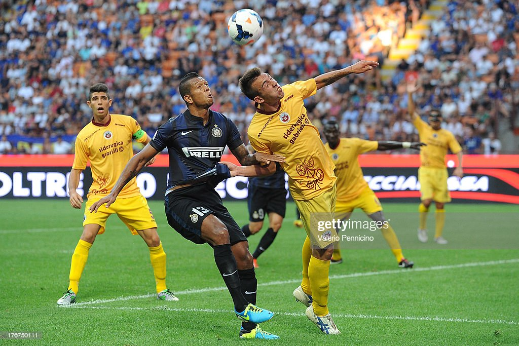 Fredy Guarin (L) of FC Internazionale Milano competes with Antonio Marino of AS Cittadella during the TIM cup match between FC Internazionale Milano and AS Cittadella at Stadio Giuseppe Meazza on August 18, 2013 in Milan, Italy.