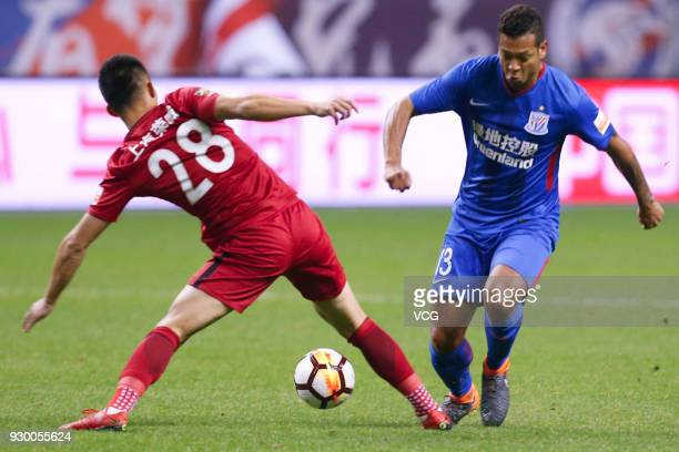 Fredy Guarin of Shanghai Greenland Shenhua and He Guan of Shanghai SIPG compete for the ball during the 2018 Chinese Football Association Super...