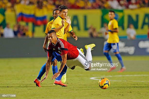 Fredy Guarín of Columbia falls after tripping on the foot of Phillipe Coutinho of Brazil during a friendly match on September 5 2014 at Sun Life...
