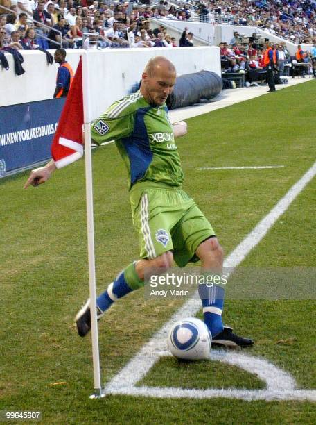 Fredy Ljungberg of the Seattle Sounders FC plays a corner kick against the New York Red Bulls during the game at Red Bull Arena on May 15 2010 in...