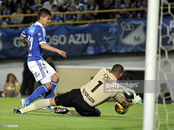 Fredy Montero of Millonarios fights for the ball with Farid Mondragon of Deportivo Cali during the match between Millonarios and Deportivo Cali as...