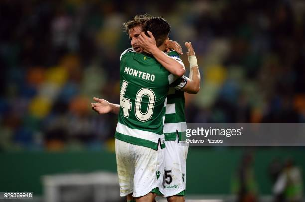 Fredy Montero of Sporting Lisbon celebrates with Fabio Coentrao mates after scores the first goal during the UEFA Europa League Round of 16 first leg...