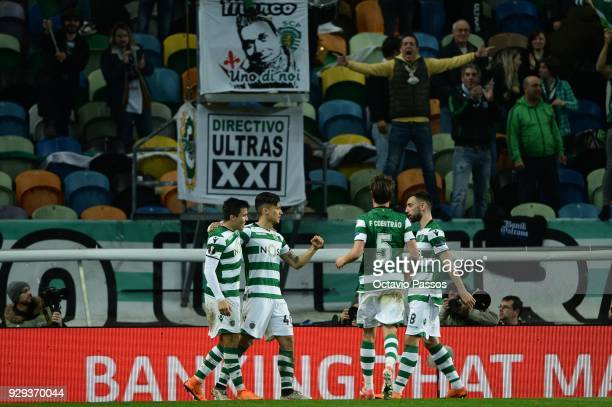 Fredy Montero of Sporting Lisbon celebrates with team mates after scores the second goal during the UEFA Europa League Round of 16 first leg match...
