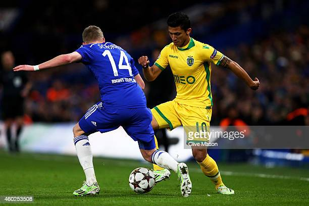 Fredy Montero of Sporting Lisbon is challenged by Andre Schuerrle of Chelsea during the UEFA Champions League group G match between Chelsea and...