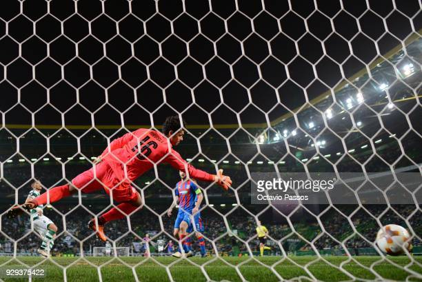 Fredy Montero of Sporting Lisbon scores the first goal during the UEFA Europa League Round of 16 first leg match between Sporting Lisbon and Viktoria...