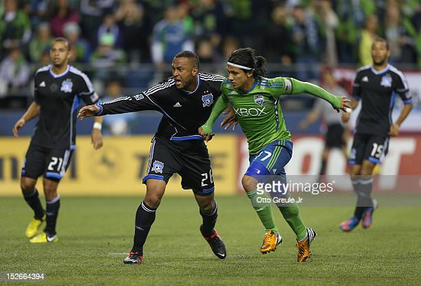 Fredy Montero of the Seattle Sounders battles Victor Bernardez of the San Jose Earthquakes at CenturyLink Field on September 22 2012 in Seattle...