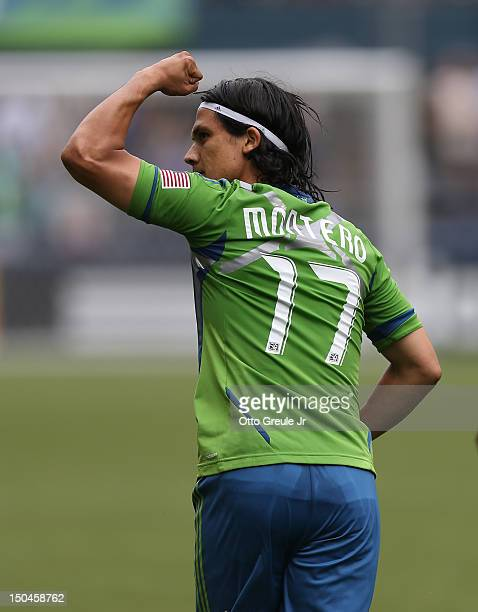 Fredy Montero of the Seattle Sounders FC celebrates after scoring a goal against the Vancouver Whitecaps at CenturyLink Field on August 18 2012 in...
