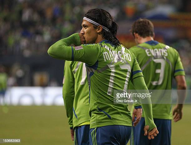 Fredy Montero of the Seattle Sounders FC celebrates after scoring a goal against the Portland Timbers at CenturyLink Field on October 7 2012 in...