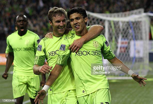 Fredy Montero of the Seattle Sounders FC celebrates with Jeff Parke after scoring a goal against the Chicago Fire during the 2011 Lamar Hunt US Open...