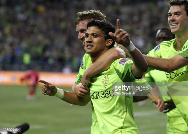 Fredy Montero of the Seattle Sounders FC celebrates with teammates after scoring a goal against the Chicago Fire during the 2011 Lamar Hunt US Open...