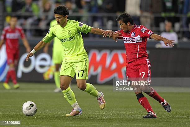 Fredy Montero of the Seattle Sounders FC dribbles against Pavel Pardo of the Chicago Fire during the 2011 Lamar Hunt US Open Cup Final at CenturyLink...