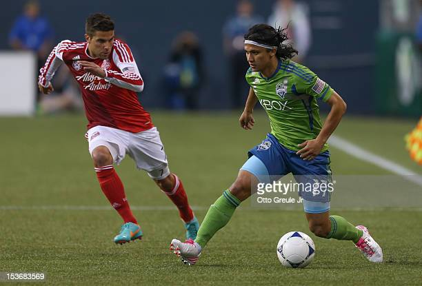 Fredy Montero of the Seattle Sounders FC dribbles against the Portland Timbers at CenturyLink Field on October 7 2012 in Seattle Washington